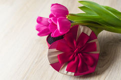 Three purple tulip and a box for gift Royalty Free Stock Photos
