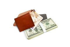 Three purse and a stack of dollars Stock Photography