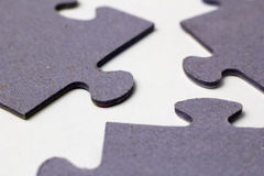 Three puzzle pieces macro Stock Photo