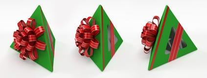 Three pyramidal green gift box with red ribbon Royalty Free Stock Image