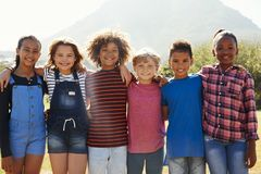 Three quarter length portrait of pre-teen friends in a park Royalty Free Stock Photography