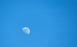 Three Quarter Moon in Blue Sky Royalty Free Stock Images
