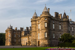 Three quarter view of the Palace of Holyroodhouse in Edinburgh,. Three-quarter view of the Palace of Holyroodhouse in Edinburgh, Scotland. The sunset light gives Stock Photo