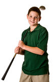 Young boy holding a golf club. A three-quarter view of a young boy holding a golf driver over his shoulder isolated on a white background Royalty Free Stock Photos