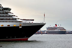 Three Queens 1. SOUTHAMPTON, UK - 5 JUNE: Cunard ships Queen Elizabeth, Queen Mary & Queen Victoria meet in the port of Southampton for the first time to Royalty Free Stock Image
