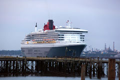 Three Queens Event 2. SOUTHAMPTON, UK - 5 JUNE: Cunard ship Queen Mary 2 sails in at dawn to meet Queen Elizabeth & Queen Victoria in the port of Southampton for Royalty Free Stock Images