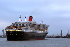 Three Queens Event 5. SOUTHAMPTON, UK - 5 JUNE: Cunard ship Queen Mary 2 sails in at dawn to meet Queen Elizabeth & Queen Victoria in the port of Southampton for Royalty Free Stock Photography