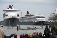 Three Queens Event 7. SOUTHAMPTON, UK - 5 JUNE: Cunard ships Queen Elizabeth, Queen Mary 2 & Queen Victoria meet in the port of Southampton for the first time to Stock Photography