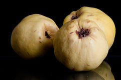 Three Quince on Black Royalty Free Stock Images