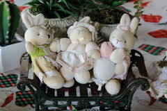 Three Rabbit Dolls On Tiny Bench Royalty Free Stock Images