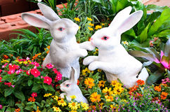 Three rabbit sculptures in garden Stock Images