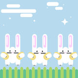 Three rabbits on the lawn with Easter eggs in clutches. vector illustration