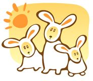 Three rabbits and sun Stock Images