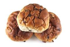 Three raisin buns. Three raising buns on a white background Stock Image