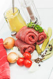 Three raw beef olives Stock Photos