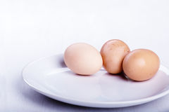 Three raw or boiled chicken eggs Stock Photos