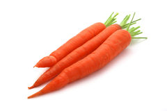 Three raw carrots on white Stock Photos