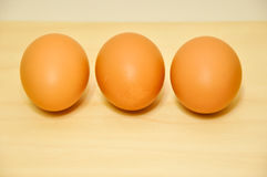Three raw egg in a row Stock Photo