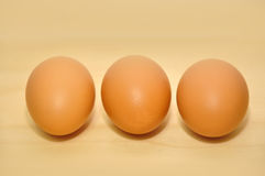 Three raw egg in a row Royalty Free Stock Photos