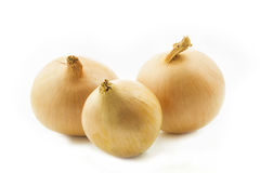 Three raw onions isolated on white Stock Photo