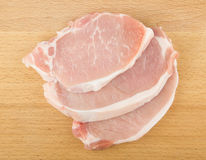 Three raw pork chops Royalty Free Stock Photography