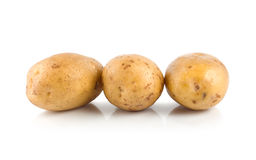 Three raw potatoes isolated on a white Royalty Free Stock Photography