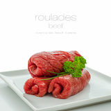 Three raw roulades beef on white plate, Royalty Free Stock Image
