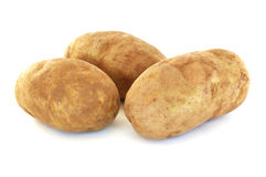 Three Raw Russet Potatoes. Isolated on White Royalty Free Stock Image