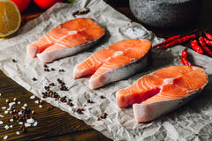 Three Raw Salmon Steaks. With Some Spices Royalty Free Stock Images