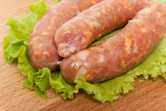 Three raw sausage Stock Images