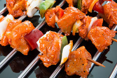 Three Raw Shaslik Skewers On A Cooking Grate With Reflections On Royalty Free Stock Photo