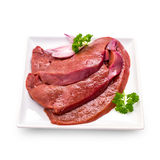 Three raw veal liver slices isolated, top view Royalty Free Stock Images