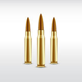 Three realistic bullets on light background Stock Photos