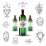 Three realistic mock up green bottle of wine and set of silhouette labels on white background Royalty Free Stock Images