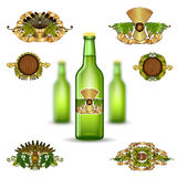 Three realistic mock up green glass bottle of beer and set of luxury labels on white background. Vector illustration one bottle sharp and two bottles depth of Stock Photography