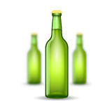 Three realistic mock up green glass bottle of beer on white background. Vector illustration one bottle sharp and two bottles depth of field Stock Photography
