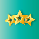 Three Realistic Origami 3D gold stars on a blue background. Stock Photo