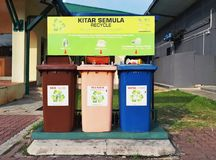 Three recycle bins for different kind of trashes located at highway rest area. IPOH, MALAYSIA – AUGUST 24, 2017 – Three recycle bins for different kind of Stock Image