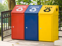 Three recycling bin. For cans, plastic and paper. Environmental protection Royalty Free Stock Images