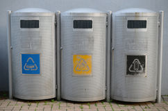 Three recycling bins. A three recycling bins Royalty Free Stock Photos