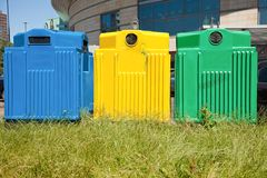 Three recycling bins in a city. Three colorful recycling bins in a city center. Paper, plastic, glass Stock Photography