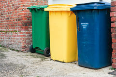 Recycling bins. Three recycling bins outside a house in UK Stock Photography