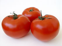 Three in red. Fresh tomatoes Royalty Free Stock Images