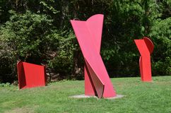 Three red abstract metal sculptures in Forest Park, Portland, Oregon. These are three red abstract metal sculptures in Forest Park, Portland, Oregon Royalty Free Stock Image