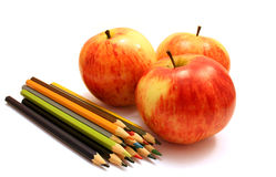 Three red apple and color pencils Royalty Free Stock Photo