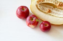 Three red Apple and cut melon next stock image