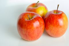 Three red apples of Fuji variety stock photos