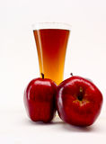 Three red apples and glass Stock Image