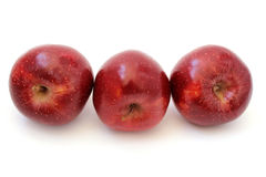 Three red apples are inclined Royalty Free Stock Images