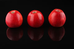 Three red apples  isolated on black Stock Images